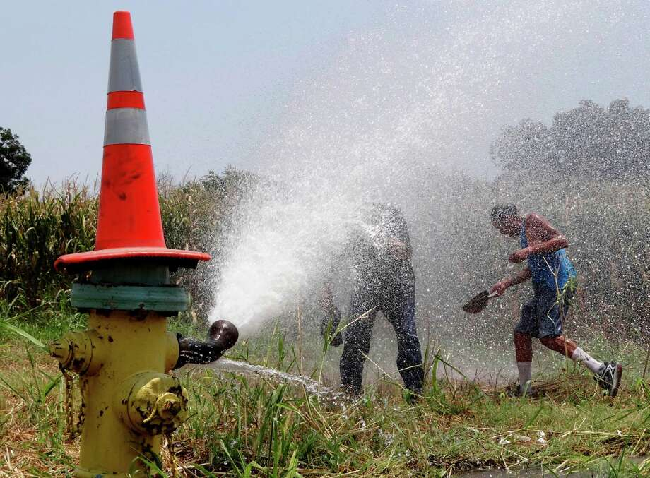 "A reader wonders if the SAWS ""water flush,"" releasing millions of gallons of water from hydrants throughout the area, could have been executed with an ""outside-the-box"" mentality to make better use of the water. Photo: Billy Calzada, San Antonio Express-News / © 2012 San Antonio Express-News"