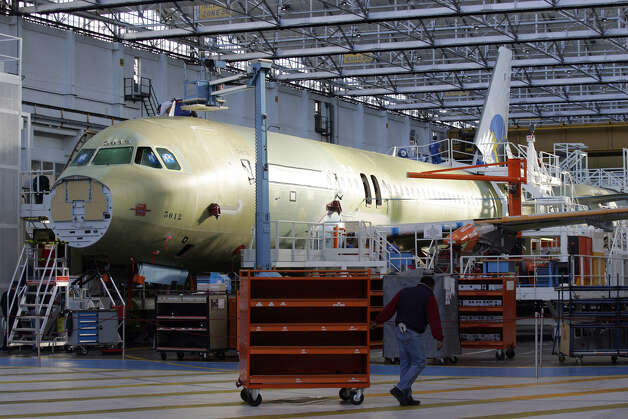 Airbus workers assemble an A320 on Nov. 30, 2006 in Toulouse-Blagnac, southern France. Photo: LIONEL BONAVENTURE, LIONEL BONAVENTURE/AFP/Getty Images