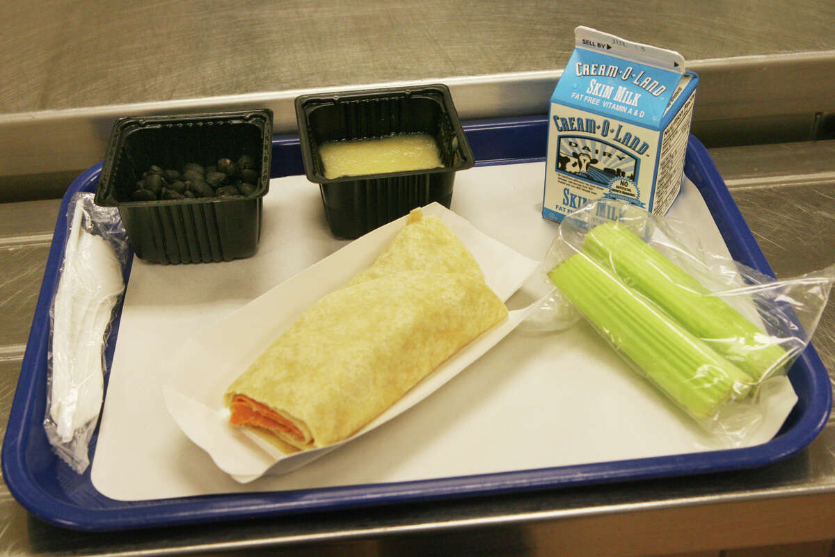 An italian wrap, applesauce, balck beans, celery, and milk are on the menu on the first day of the lunch program at Cesar Batalla School in Bridgeport, Conn. on Monday, July 2, 2012. The lunch is part of the Seamless Summer Meals program offered in 82 sites around Bridgeport. Any child under 18 years of age can walk in and have breakfast and lunch.