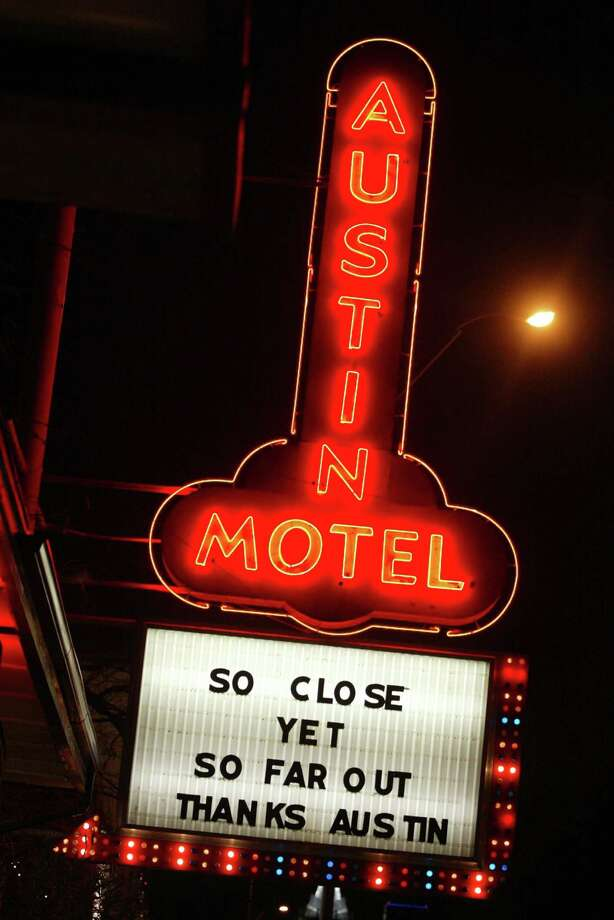 The famous neon sign outside the Austin Motel in Austin, Texas, helps lure the curious into the old-school charm of the motel.  Photo: JILL JOHNSON, KRT / FORT WORTH STAR-TELEGRAM