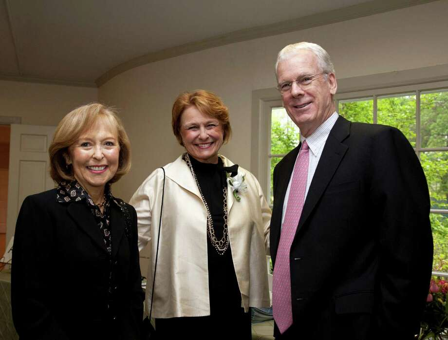 Jane Kiefer, center, executive director of the Norwalk Community College Foundation, is shown with New Canaan residents Hazel and Michael Hobbs. Photo: Contributed Photo