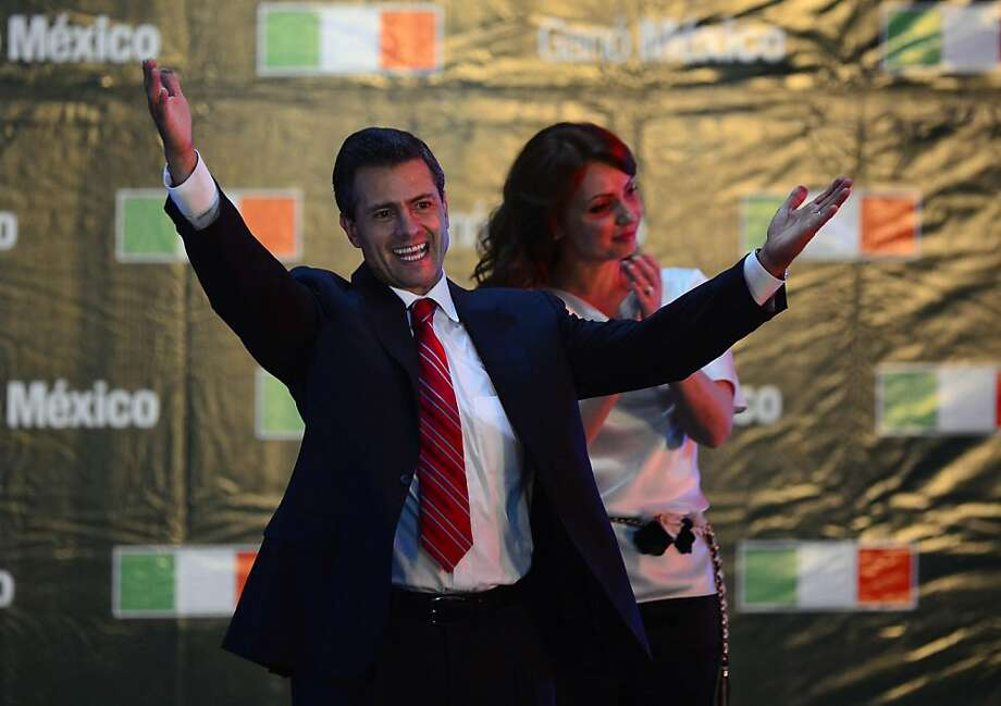 The Mexican presidential candidate for the Institutional Revolutionary Party (PRI), Enrique Peña Nieto (L), accompanied by his wife Angelica Rivera, celebrates after learning the first official results of the presidential election, at the party's headquarters in Mexico City on July 1, 2012. Peña Nieto, the new face of the party that governed Mexico for seven decades, won Sunday's presidential election, according to first official results by the independent Federal Electoral Institute (IFE). Peña Nieto had around 38 percent of the vote against around 31 percent for his nearest rival, leftist Lopez Obrador from the Party of the Democratic Revolution (PRD), according to the early count.  AFP PHOTO/Alfredo ESTRELLAALFREDO ESTRELLA/AFP/GettyImages Photo: Alfredo Estrella, AFP/Getty Images
