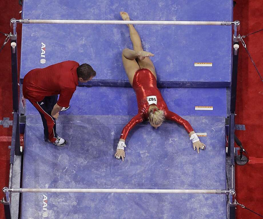 Trials and error:Nastia Liukin lies on the mat after falling 