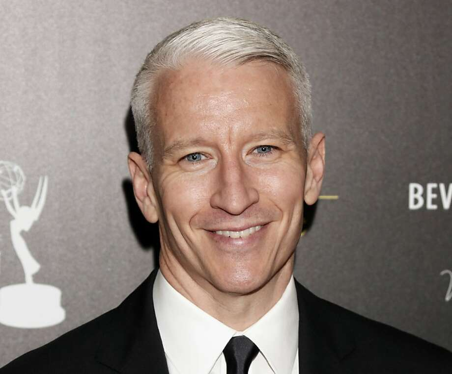 "FILE - This June 23, 2012 file photo shows CNN's Anderson Cooper arrives at the 39th Annual Daytime Emmy Awards at the Beverly Hilton Hotel in Beverly Hills, Calif. Cooper came out in a letter online, saying ""the fact is, I'm gay."" He said Monday, July 2, in a note to the Daily Beast's Andrew Sullivan that he had kept his sexual orientation private for personal and professional reasons, but came to think that remaining silent had given some people an impression that he was ashamed. (Photo by Todd Williamson/Invision/AP, file) Photo: Todd Williamson, Associated Press"