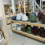 San Francisco  Heath Ceramics: This huge warehouse showroom shows off the colorful hand-glazed clay dinnerware first created by Sausalito's Edith Heath in 1948. There are comfy couches and books, fine tabletop textiles and whimsical totes, a Blue Bottle cafe and a large tile showroom (and a tile factory opening soon). Current seasonal ceramic colors include bright blue and cool green. Staffers still wrap your purchases in newspaper, just like the old days. 2900 18th St., (415) 361-5552, Ext. 13, www.heathceramics.com.
