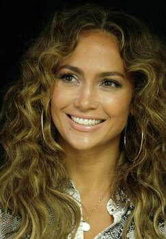 Jennifer Lopez poses for photos after a ceremony at which she donated medical equipment to The Children's Hospital, via the Lopez Family Foundation, in Panama City, Tuesday, June 12, 2012. Lopez will perform on June 14 as part of her Dance Again world tour that kicks off in Panama City. Photo: AP