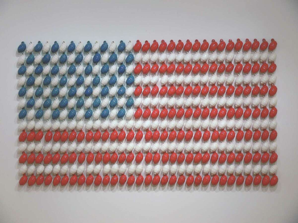 """In """"Stars and Stripes,"""" Angela Carbone creates an American flag with ceramic grenades."""