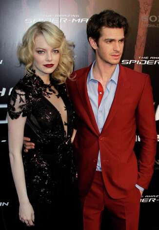 US actress Emma Stone, left, and British actor Andrew Garfield arrive for the French premiere of The Amazing Spider-Man at a central Paris cinema, Tuesday, June 19, 2012. (AP Photo/Francois Mori) Photo: Francois Mori, STF / AP