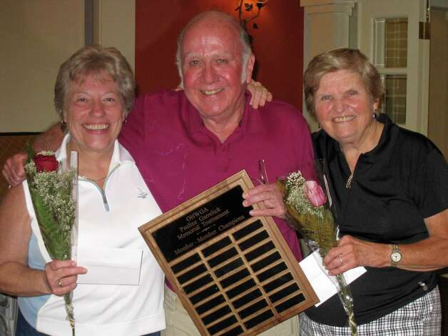 The Oak Hills Women's Golf Association held the first Pauline Garrelick Memorial Member Tournament on June 28 in Norwalk. Stuart Garrelick, center, is pictured with the low gross winners Pat Williams, left, and Terry Kolenda, right. Photo: Contributed Photo