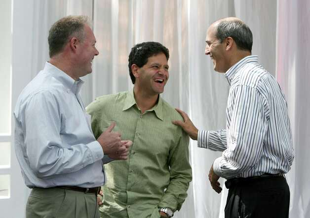 Kevin Johnson, left, president of Microsoft's Platforms & Services Division, shares a laugh with aQuantive co-Founder Nick Hanauer, center, and former CEO Brian McAndrews on Aug. 13, 2007, after Microsoft completed its $6.3 billion aquisition of Seattle-based online marketing and advertising company. Photo: Scott Eklund, Seattle Post-Intelligencer / Seattle Post-Intelligencer