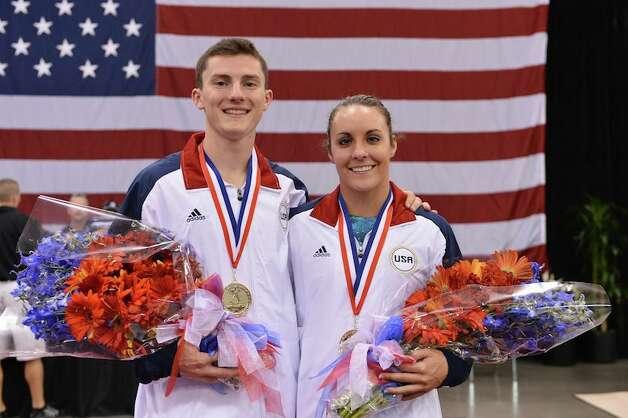 Savannah Vinsant of Newton, right, and Steven Gluckenstein, left, will represent the U.S. in trampoline. Photo: John Cheng/USA Gymnastics