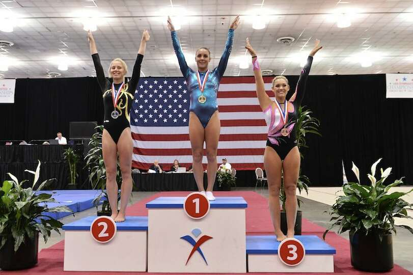 Savannah Vinsant of Newton, center, won the U.S. Olympic Trials in trampoline.