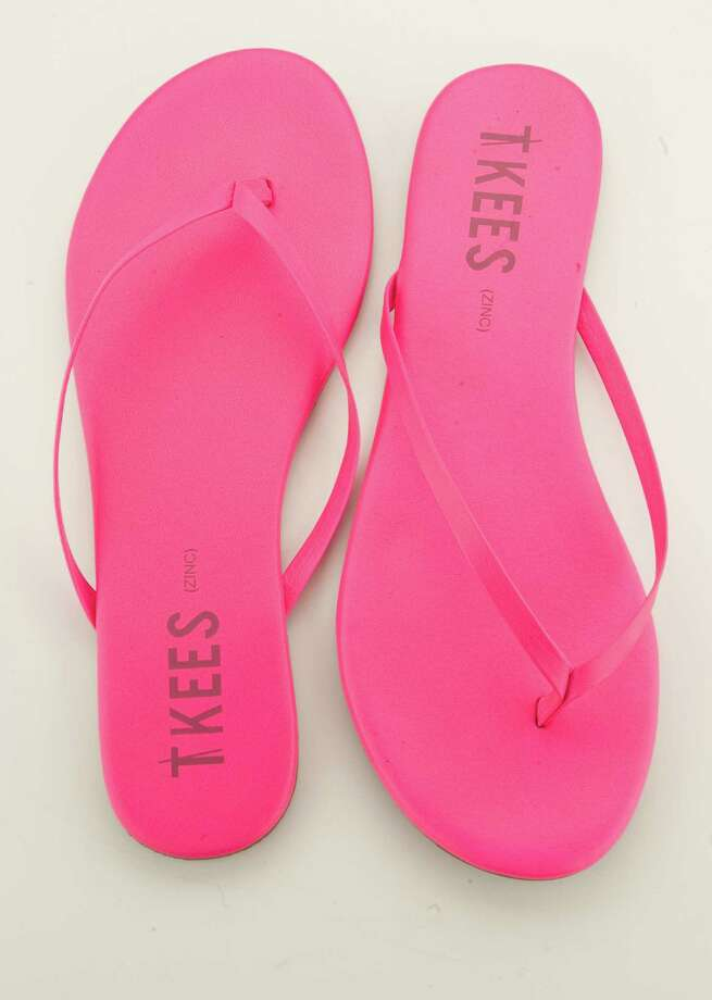 Tkees fuschia flip-flops, $48 at Longoria Collection. Goes with Raquel Segal. Photo: Nick De La Torre / © 2012  Houston Chronicle