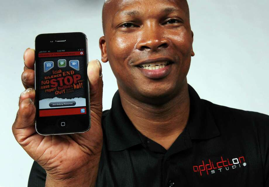 Appddiction Studio president and CEO Tim Porter presents his company's latest app, Stop Bullies, on Friday, June 29, 2012. The app has earned Appddiction Studio recognition from USA Network's Characters United for their efforts to end prejudice and discrimination. The app provides a way for people to report on evidence of bullying or harassment to school administrators. Photo: Kin Man Hui, San Antonio Express-News / ©2012 San Antonio Express-News
