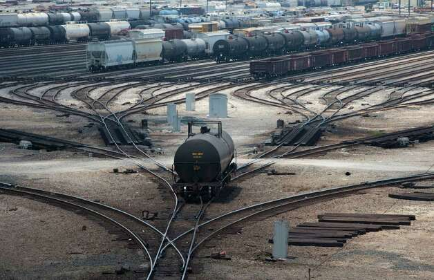 A tanker car rolls down the hump at the Englewood Yard, Thursday, June 28, 2012, in Houston. The train yard is the biggest in Texas and has 64 classification ties. Union Pacific  has spent $17 million replacing about 100,000 ties. Photo: Nick De La Torre, Houston Chronicle / © 2012  Houston Chronicle