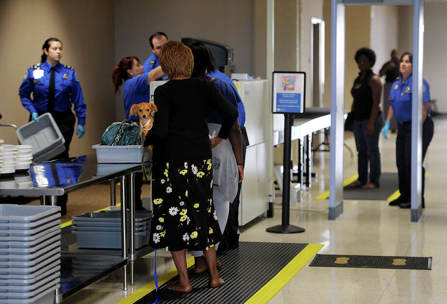 Travelers pass through security at the Jack Brooks Regional Airport on Wednesday.  Photo taken Wednesday, June 20, 2012 Guiseppe Barranco/The Enterprise Photo: Guiseppe Barranco, STAFF PHOTOGRAPHER / The Beaumont Enterprise