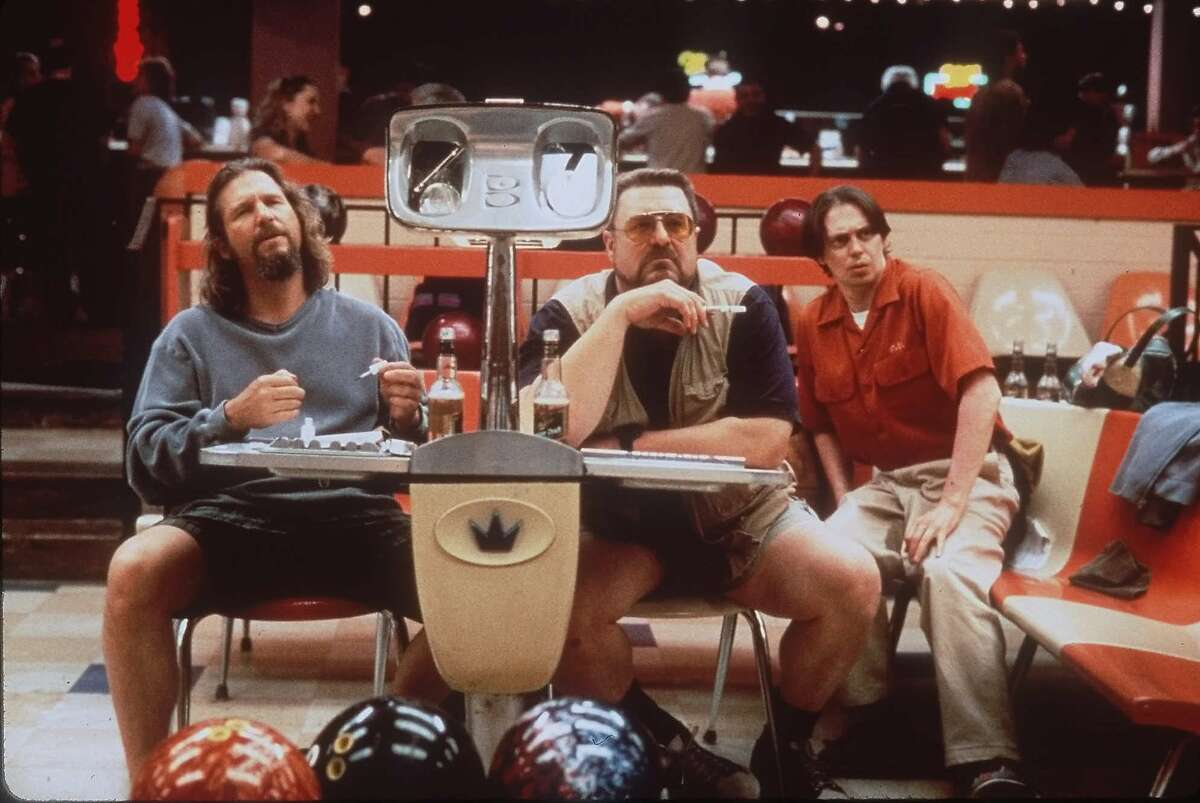Jeff Bridges, left, John Goodman, center, and Steve Buscemi appear in a scene from the motion picture