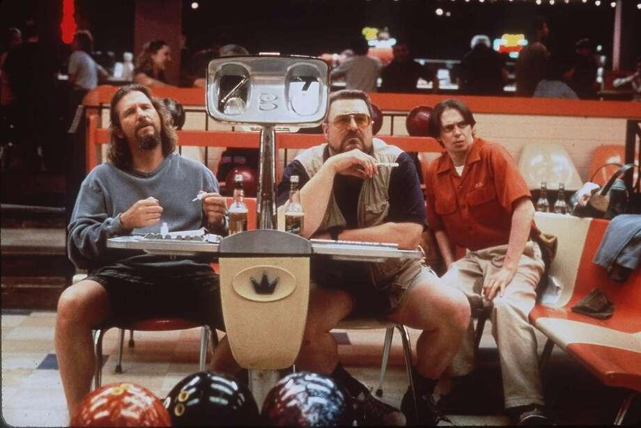 "Jeff Bridges, left, John Goodman, center, and Steve Buscemi appear in a scene from the motion picture ""The Big Lebowski."" (AP Photo) Photo: Merrick Morton, ASSOCIATED PRESS"