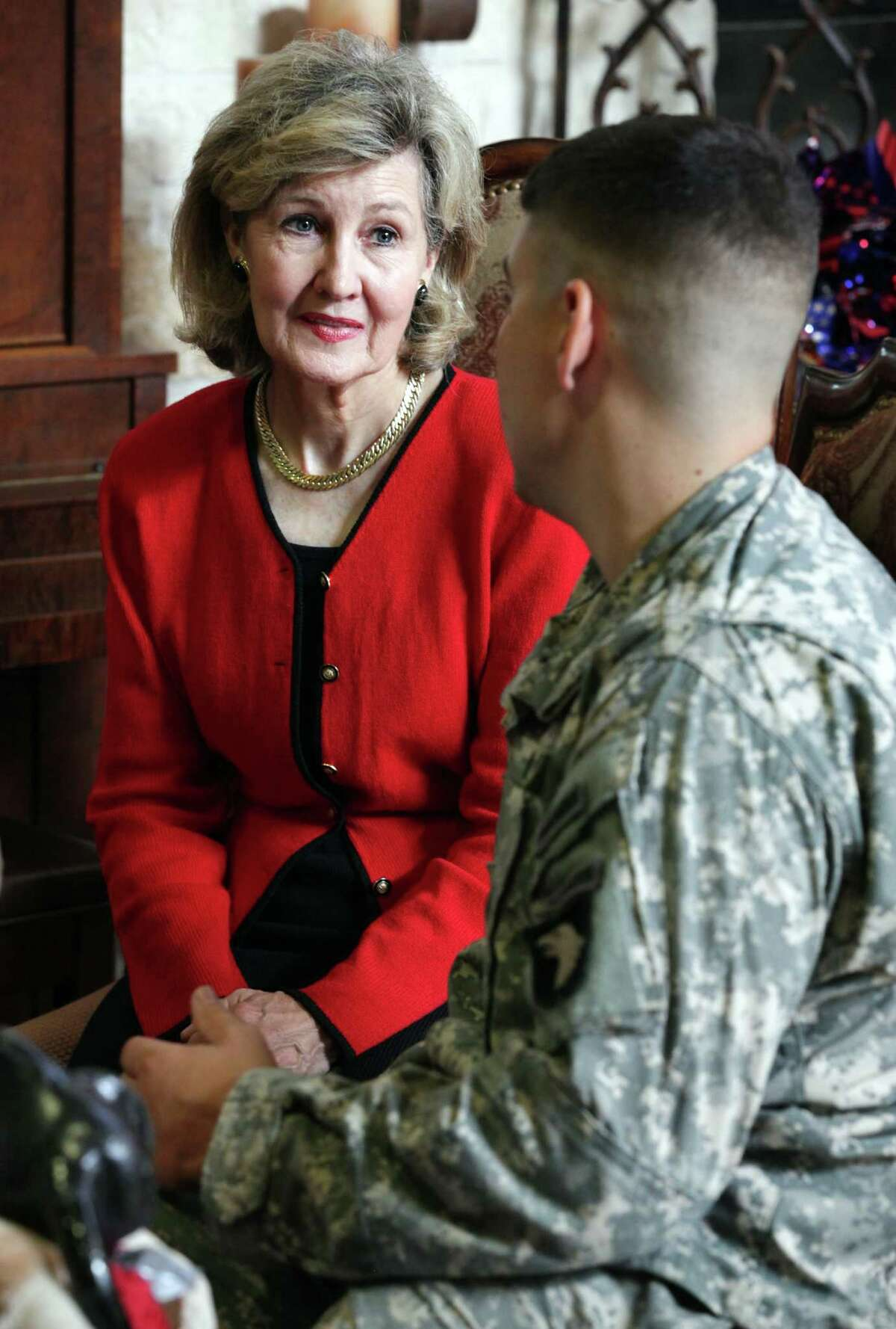 Sen. Kay Bailey Hutchison, left, listens to Capt. Larkin O'Hern, an injured warrior, during a visit to the Warrior and Family Support Center at Fort Sam Houston, Monday, July 2, 2012.