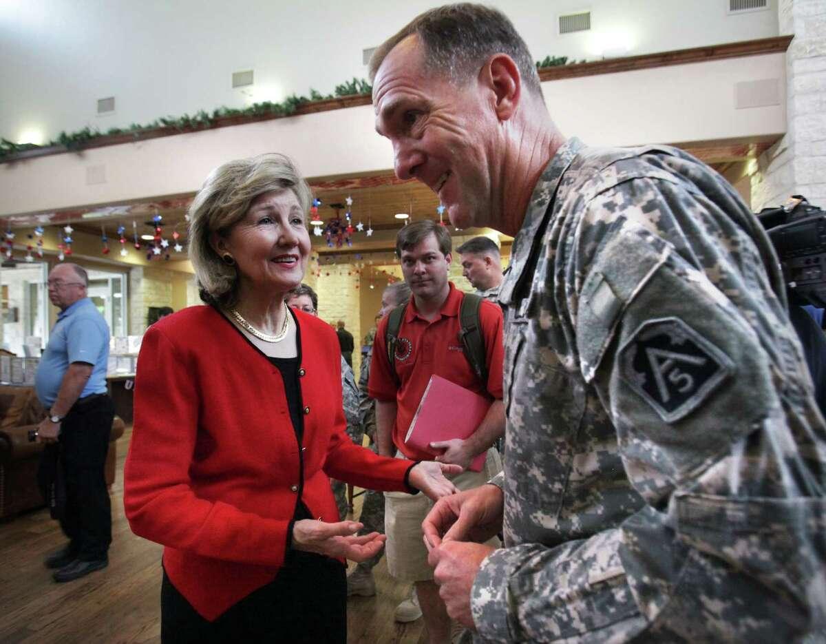 Sen. Kay Bailey Hutchison, talks with Maj. Gen. Walter L. Davis, during Monday's visit to Fort Sam Houston.