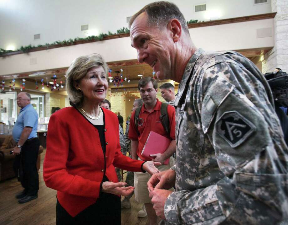 Sen. Kay Bailey Hutchison, talks with Maj. Gen. Walter L. Davis, during Monday's visit to Fort Sam Houston. Photo: BOB OWEN, San Antonio Express-News / © 2012 San Antonio Express-News