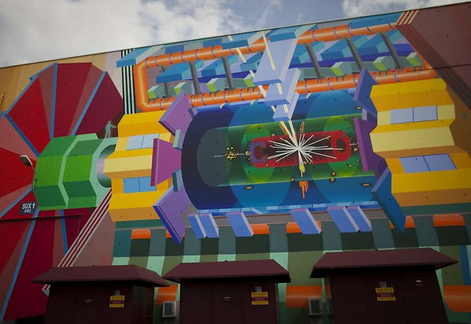 FILE - In this May 20, 2011 file photo, a wall painting by artist Josef Kristofoletti  is seen at the Atlas experiment site at the  European Center for Nuclear Research, CERN, outside Geneva, Switzerland. The painting shows how a Higgs boson may look. Scientists at CERN plan to make an announcement on Wednesday, July 4, 2012 about their hunt for the elusive sub-atomic particle. Physicists have said previously they are increasingly confident that they are closing in on it based on hints at its existence hidden away in reams of data. (AP Photo/Anja Niedringhaus) Photo: Anja Niedringhaus, Associated Press