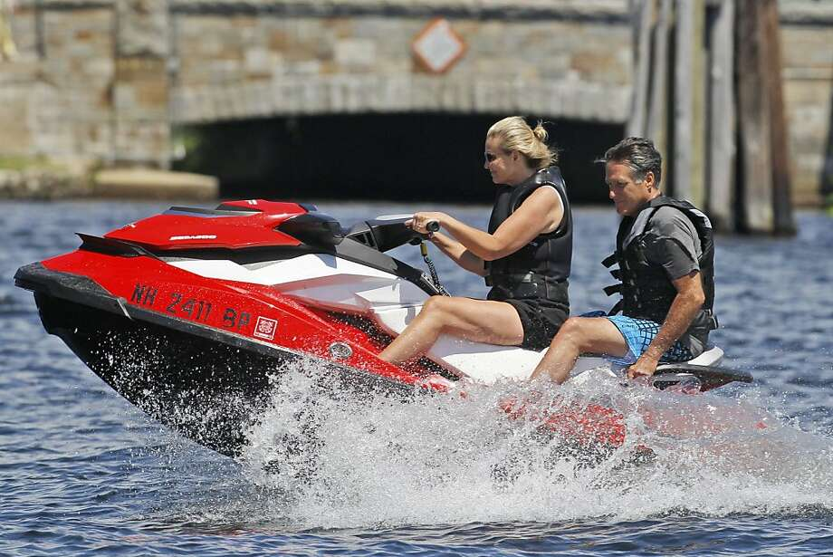 Republican presidential candidate Mitt Romney, former Massachusetts Gov. and wife Ann Romney jet ski on Lake Winnipesaukee in Wolfeboro, N.H., Monday, July 2, 2012. (AP Photo/Charles Dharapak) Photo: Charles Dharapak, Associated Press