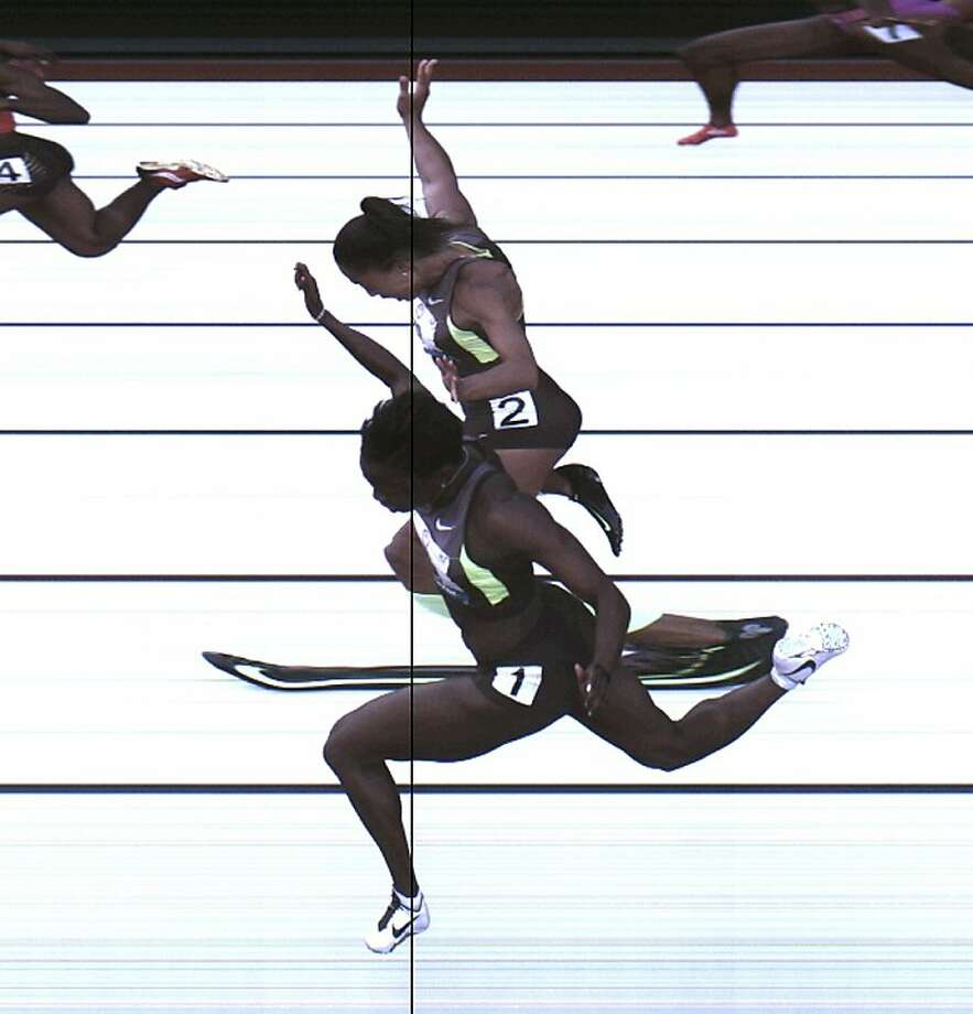 This Saturday, June 23, 2012, photo provided by USA Track & Field shows the third-place finish of the women's 100-meter final from a photo-finish camera, shot at 3,000-frames-per-second, during the U.S. Olympic Track and Field Trials in Eugene, Ore. AllysonFelix and Jeneba Tarmoh, in foreground, finished in a dead heat for the last U.S. spot in the 100 to the London Games, each leaning across the finish line in 11.068 seconds. (AP Photo/USA Track & Field) Photo: Associated Press