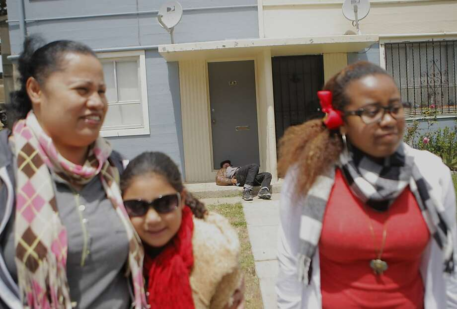 Maria Radford, her niece, Selestina Mauga, 7, and her daughter, Eugenia Radford, 15, stand in Sunnydale, Eugenia says that she does not feel safe there. Photo: Megan Farmer, The Chronicle