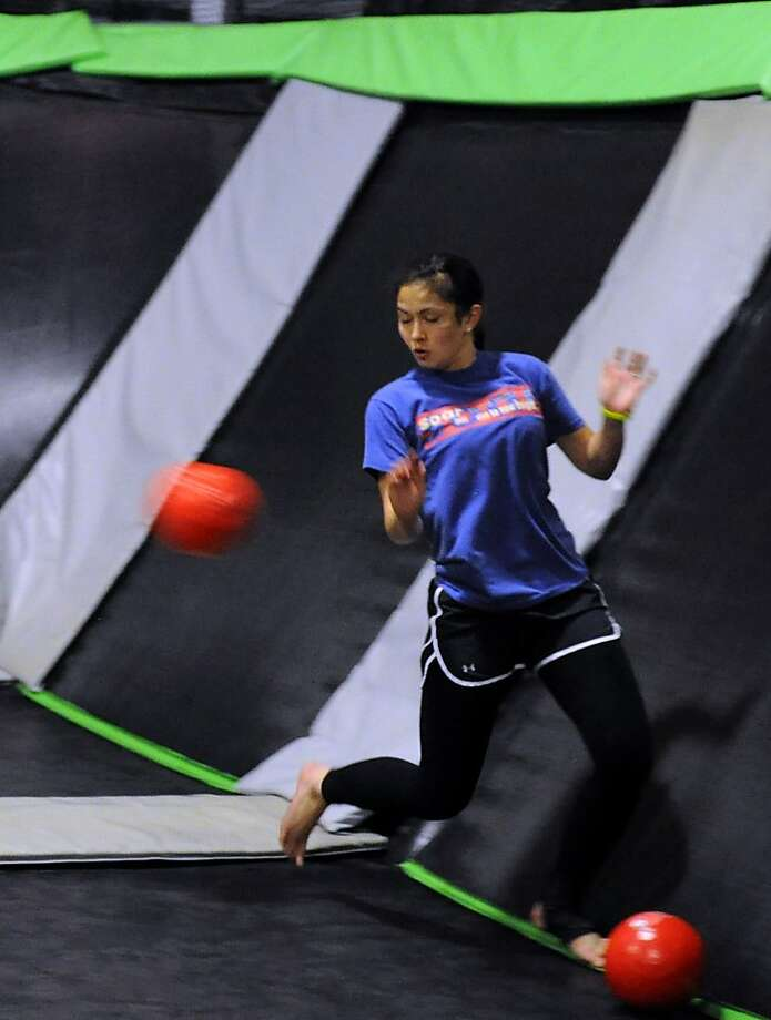 In this handout photo Kalei Patterson, 22, of San Francisco competes in a dodgeball tournament at House of Air in San Francisco. Photo: Eddie Tallman, House Of Air