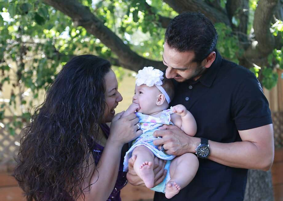 Michelle Fry-Villanueva, Jesus Villanueva and 7-month old Mila Villanueva in their home on Wednesday, June 20th, 2012 in San Jose, Calif. Photo: Jill Schneider, The Chronicle