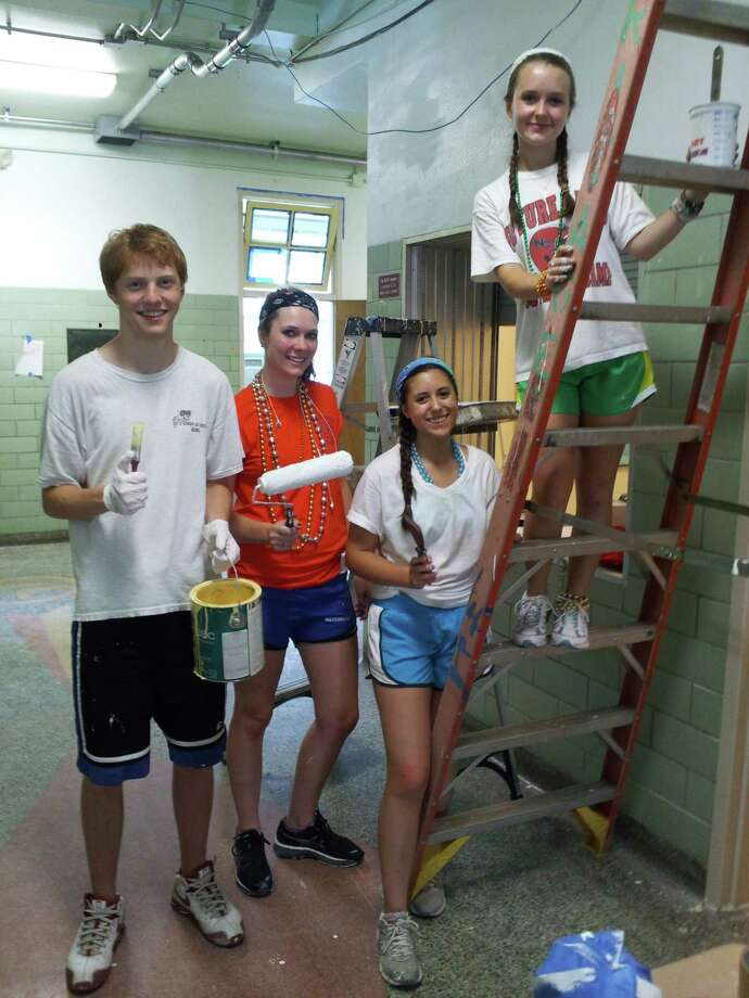 Students from the First Presbyterian Church of New Canaan traveled to New Orleans to help with the rebuilding effort. Above, Connor Allsteadt, Whitney Gulden, Libby Robinson and Taylor Ferguson paint an elementary school for developmentally disabled students. Photo: Contributed Photo