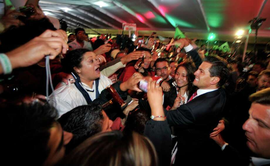 Mexican President-elect Enrique Peña Nieto, celebrating with supporters in Mexico City on Monday, will face continued political gridlock as he sets out to usher in reforms. Photo: Daniel Aguilar / 2012 Getty Images