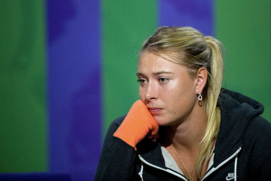 Maria Sharapova couldn't hide her disappointment at a news conference following her loss Monday. Photo: Tom Lovelock / AELTC