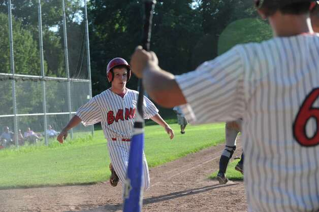 BANC's Jack Burke runs to home base against Rink & Racquet at George M. Weiss Senior Babe Ruth Tournament at Havemeyer Field Monday, July 2, 2012. Photo: Helen Neafsey / Greenwich Time