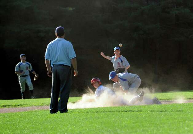 BANC's #1 Matt Condon slides into second base against Rink & Racquet at George M. Weiss Senior Babe Ruth Tournament at Havemeyer Field Monday, July 2, 2012. BANC won 12 to 1. Photo: Helen Neafsey / Greenwich Time