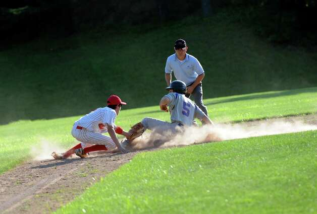 Rink & Racquet's John Crist slides into third base against BANC at George M. Weiss Senior Babe Ruth Tournament at  Havemeyer Field Monday, July 2, 2012. BANC won 12 to 1. Photo: Helen Neafsey / Greenwich Time