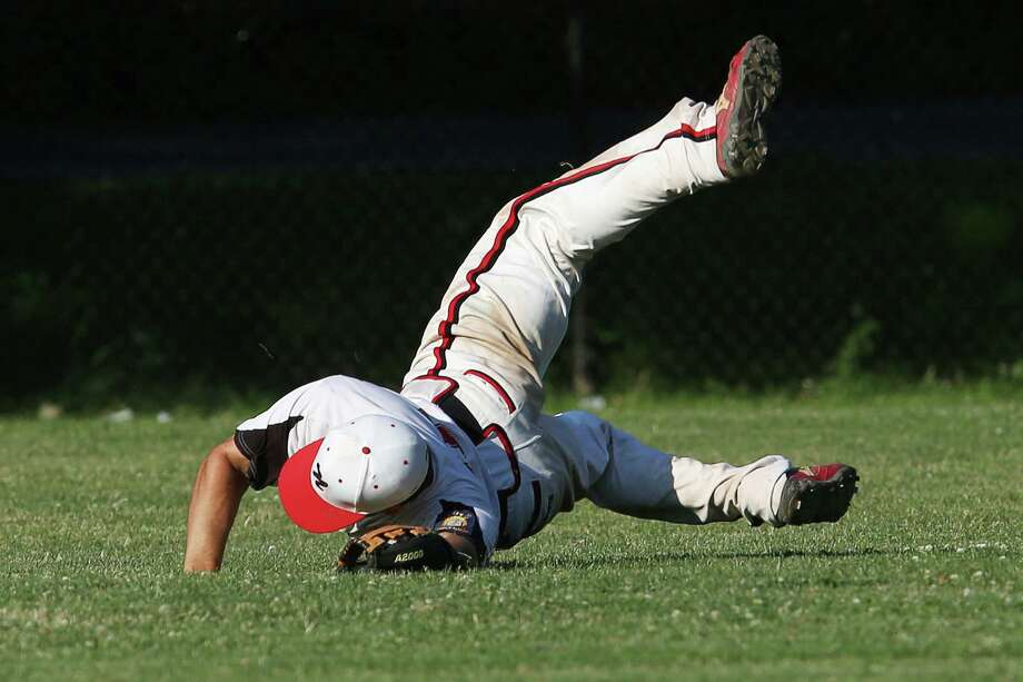 Mike Ross Connecticut Post freelance - Norwalk Senior Legion centerfielder #15 Spencer Jacoby dives for the ball during Monday afternoon match up against Westport. Jacoby would catch the ball to end the inning despite being shaken up on the play. Photo: Mike Ross / Connecticut Post Freelance
