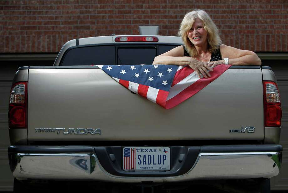 "Linda Trocko of Spring has one of the more than 100 specialty-plate designs the state offers. ""I'm very patriotic,"" she said. The equestrian enthusiast got her plates with a personalized message. Photo: Karen Warren / © 2012  Houston Chronicle"