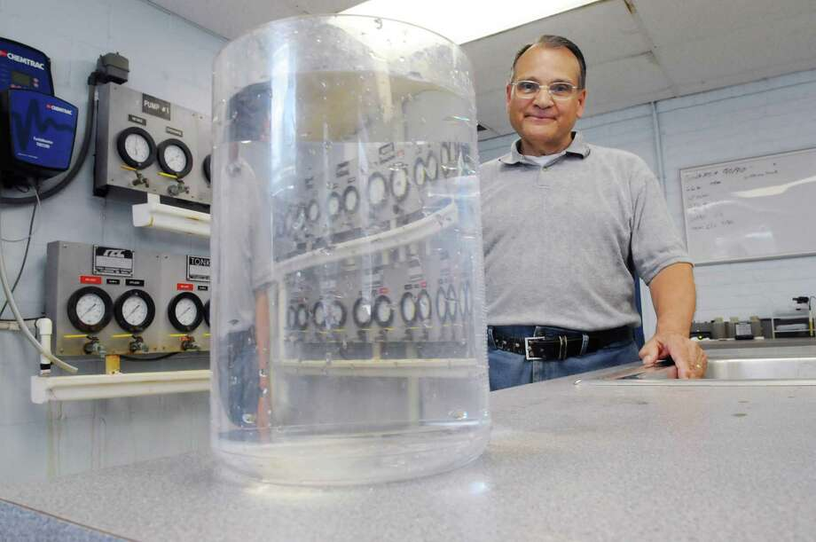 John Basile, deputy mayor/trustee for the Village of Stillwater stands in the control room inside the former water treatment plant on Monday, July 2, 2012 in Stillwater, NY.  On the counter is a beaker with water the village now gets from the Saratoga County Water Authority.   The water plant was shut down because PCBs were found in the water.   (Paul Buckowski / Times Union) Photo: Paul Buckowski