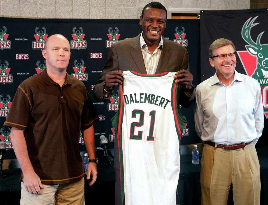 Newly acquired Milwaukee Bucks center Samuel Dalembert, center, poses with head coach Scott Skiles, left, and general manager John Hammond before an NBA basketball news conference, Monday, July 2, 2012, in Milwaukee. The Bucks traded Jon Leuer, Jon Brockman and Shaun Livingston to the Houston Rockets to get Dalembert, and the two teams also traded draft picks, which Milwaukee used to get North Carolina forward John Henson. (AP Photo/Milwaukee Journal-Sentinel, Mark Hoffman)  NO SALES; TV OUT; MAGS OUT Photo: Mark Hoffman / Milwaukee Journal-Sentinel