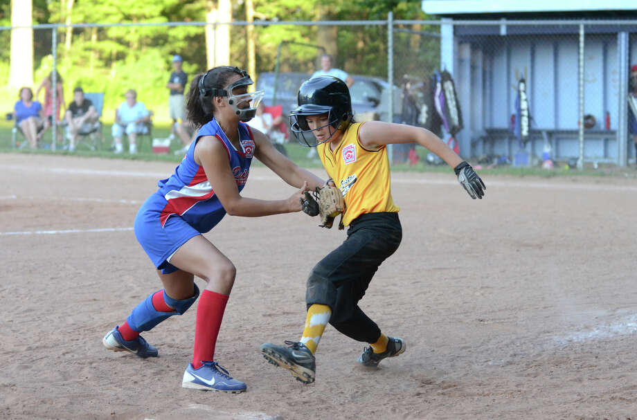 Darien's Leela Krishnan (15) tags Redding-Easton's Esme Miano (3) in a rundown at third base during the Little League Softball finals District 1 final at Middlebrooks Middle School in Wilton on Monday, July 2, 2012. Photo: Amy Mortensen / Connecticut Post Freelance