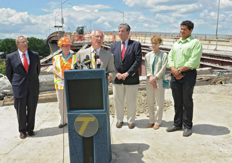 Congressman Paul Tonko speaks during a press conference on the Congress Street Bridge to discuss plans to rehab bridges throughout the region Monday, July 2, 2012 in Troy, N.Y. In back of Tonko from left are, Troy Mayor Lou Rosamilia, Joan McDonald, DOT Commissioner, NY Senator Neil Breslin, Lynn Kopka, city council president, and Rodney Wiltshire, at-large councilman. (Lori Van Buren / Times Union) Photo: Lori Van Buren