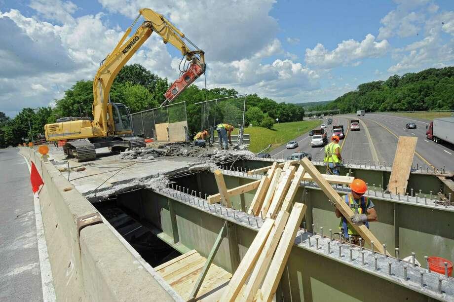 Construction crews work on the Washington Ave. bridge over I-90 Monday, July 2, 2012 in Rensselaer, N.Y. (Lori Van Buren / Times Union) Photo: Lori Van Buren