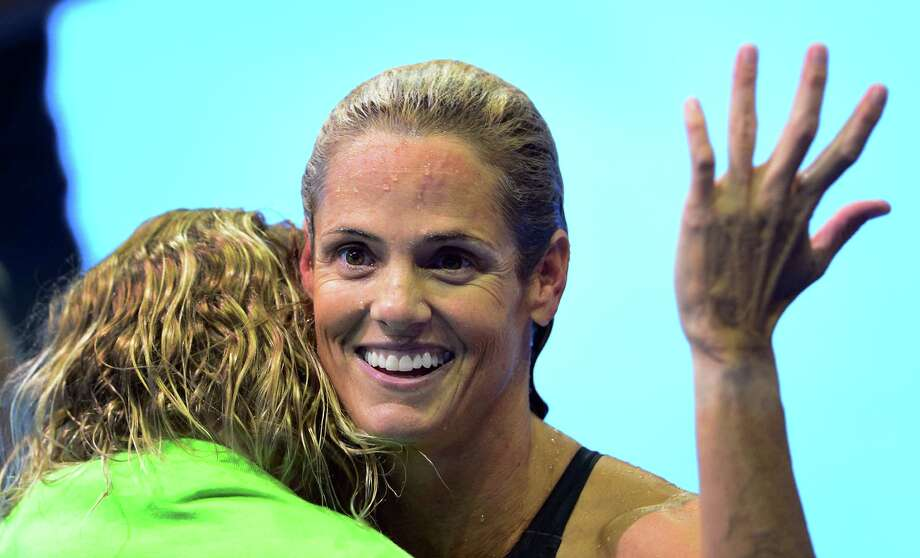 While holding 6-year-old daughter Tessa, Dara Torres, 45, accepts in good spirits her inability to make a sixth U.S. Olympic team. Photo: FREDERIC J. BROWN / AFP