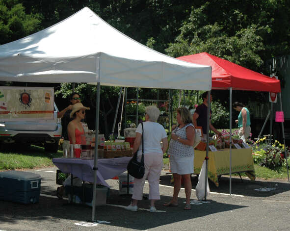 Shoppers browse  the New Canaan Farmers Market Saturday, June 30, 2012. Photo by Mac McDonough, New Canaan, Conn. Photo: Contributed Photo