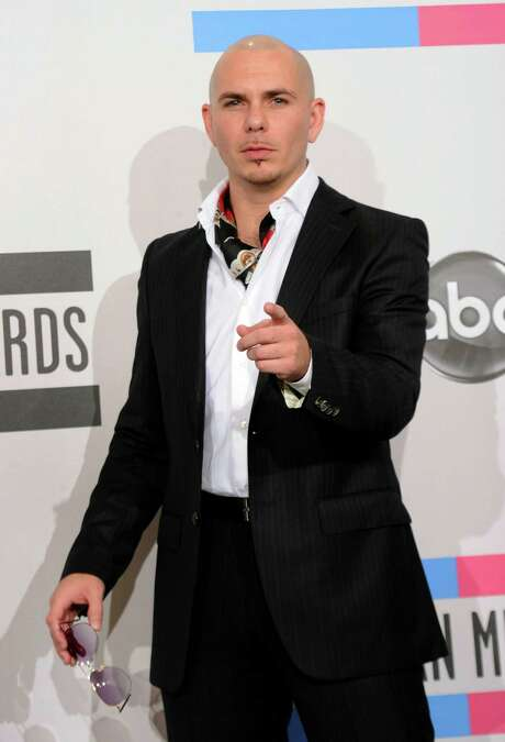 LOS ANGELES, CA - NOVEMBER 21:  Singer Pitbull poses in the press room during the 2010 American Music Awards held at Nokia Theatre L.A. Live on November 21, 2010 in Los Angeles, California.  (Photo by Jason Merritt/Getty Images for DCP) Photo: Jason Merritt / Getty Images North America