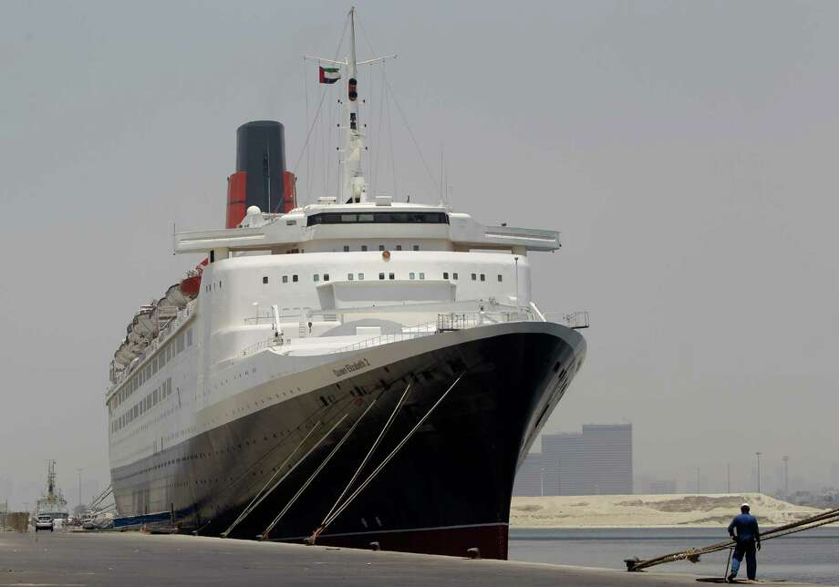 The Queen Elizabeth 2 is seen at dock as Istithmar World, the Dubai state investment company that owns the ship, outlined plans Monday to turn the retired cruise liner into a 300-room hotel, ending years of speculation about its fate, in Port Rashid, Dubai, United Arab Emirates, Monday, July 2, 2012. Britain's Queen Elizabeth II launched the QE2 in 1967. (AP Photo/Kamran Jebreili) Photo: Kamran Jebreili / AP