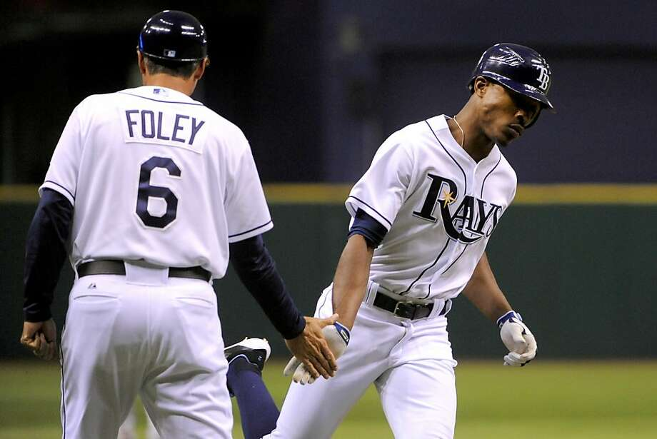 Tampa Bay Rays' B.J. Upton, right, slaps hands with third base coach Tom Foley as he rounds the bases after hitting a solo home run off of New York Yankees pitcher Freddy Garcia during the fourth inning of a baseball game, Monday, July 2, 2012, in St. Petersburg, Fla. (AP Photo/Brian Blanco) Photo: Brian Blanco, Associated Press