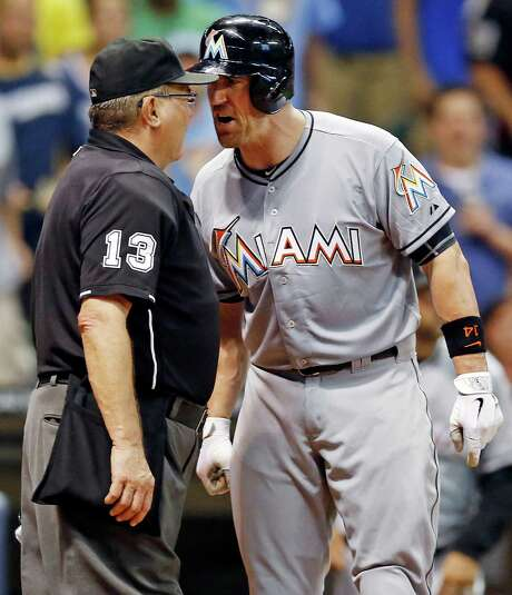 Umpire Derryl Cousins and the Marlins' John Buck are seeing eye-to-eye, but not over Buck's strikeout, leading to his ejection Monday night. Photo: Tom Lynn / FR170717 AP